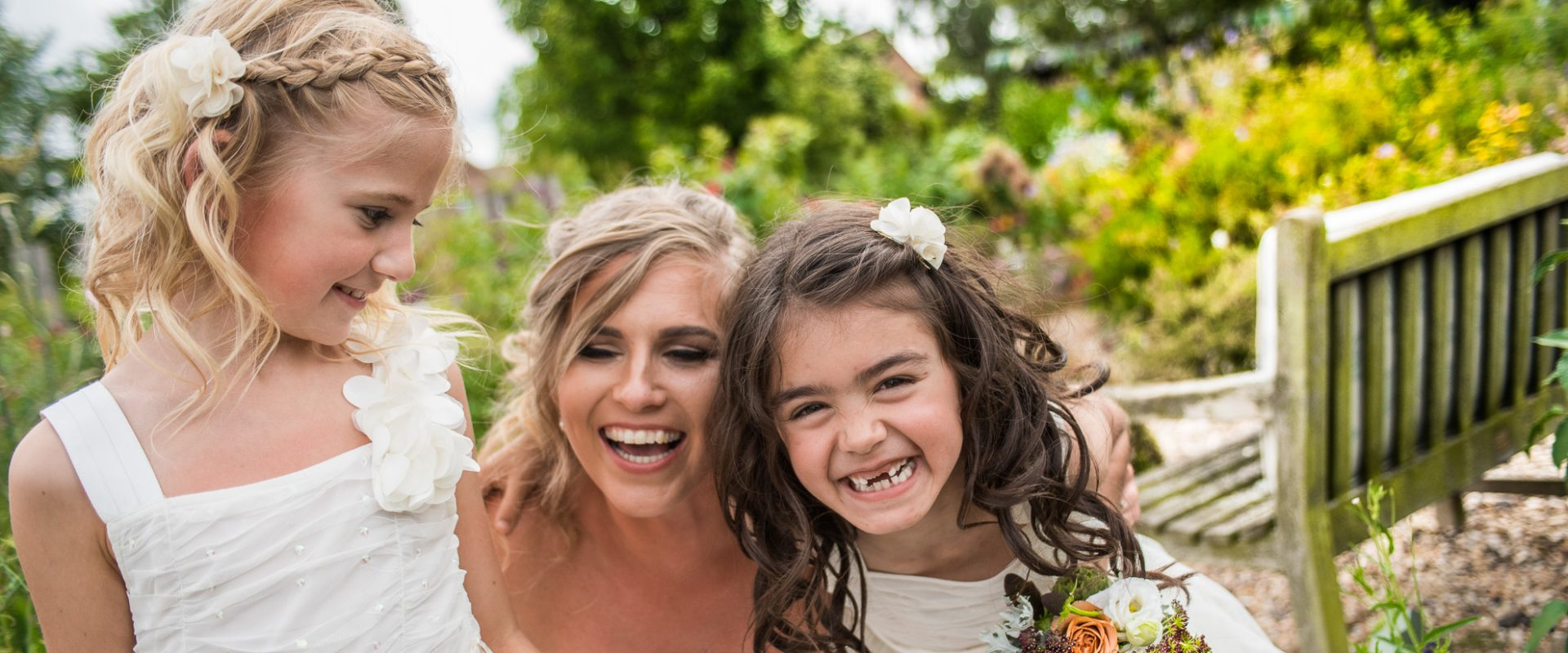 bride with flower girls laughing
