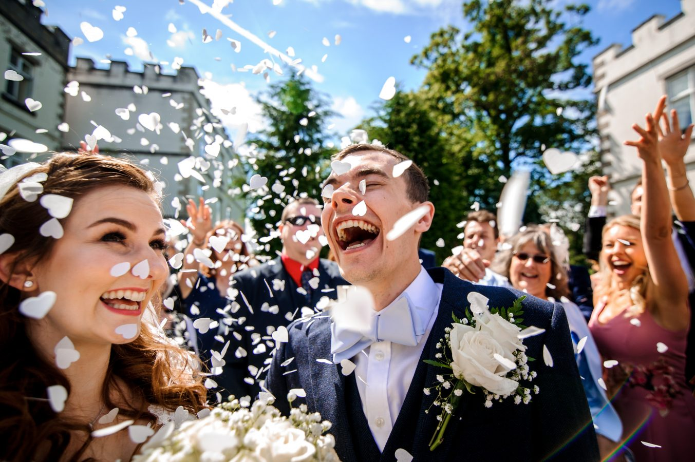 Bride-and-groom-in-grounds-confetti-dunkenhalgh-hotel