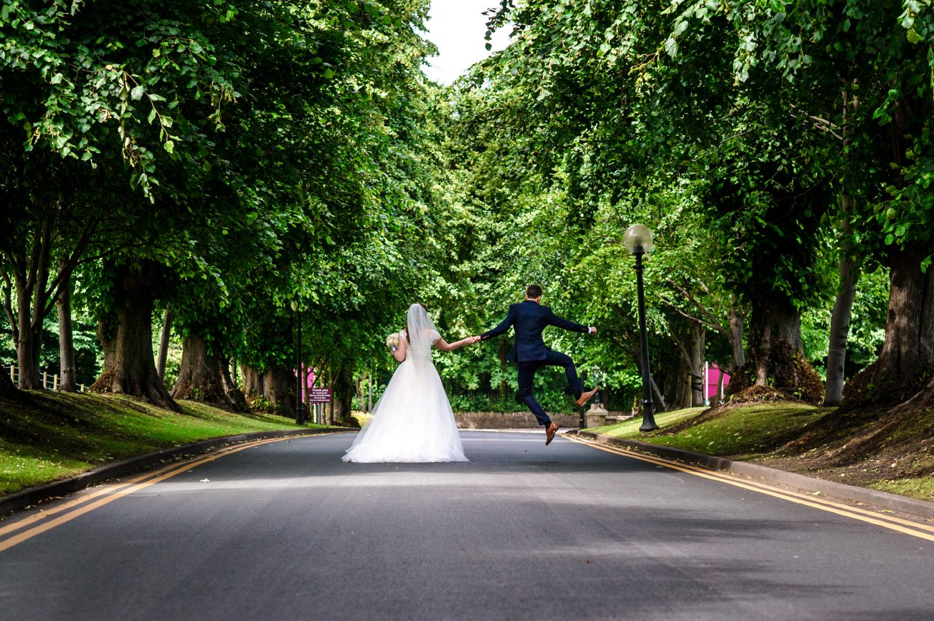 Bride-and-groom-in-grounds-groom-leap-dunkenhalgh-hotel