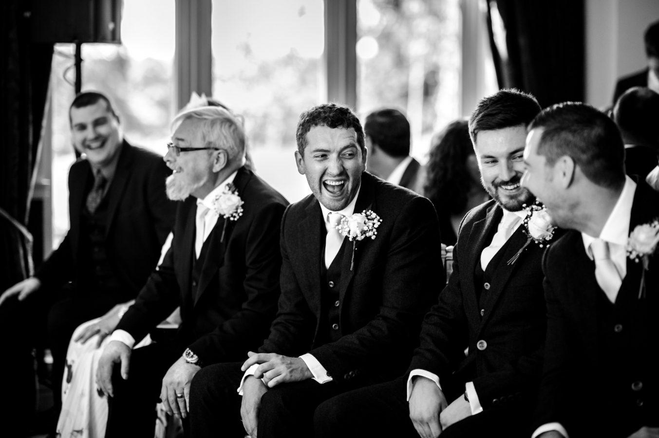 groomsmen-laughing-ceremony-dunkenhalgh-hotel