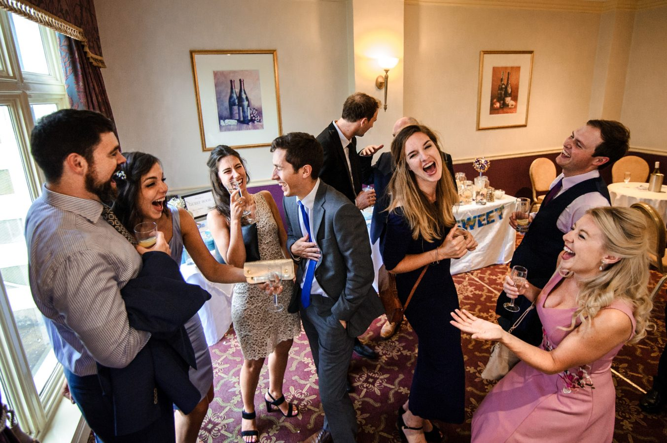 wedding-guests-laughing-dunkenhalgh-hotel