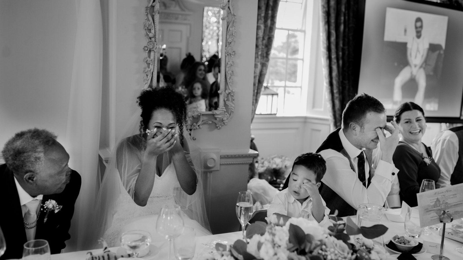 best-wedding-photos-2017-kimberley-and-joseph-bride-and-groom-laugh-at-best-man-speech