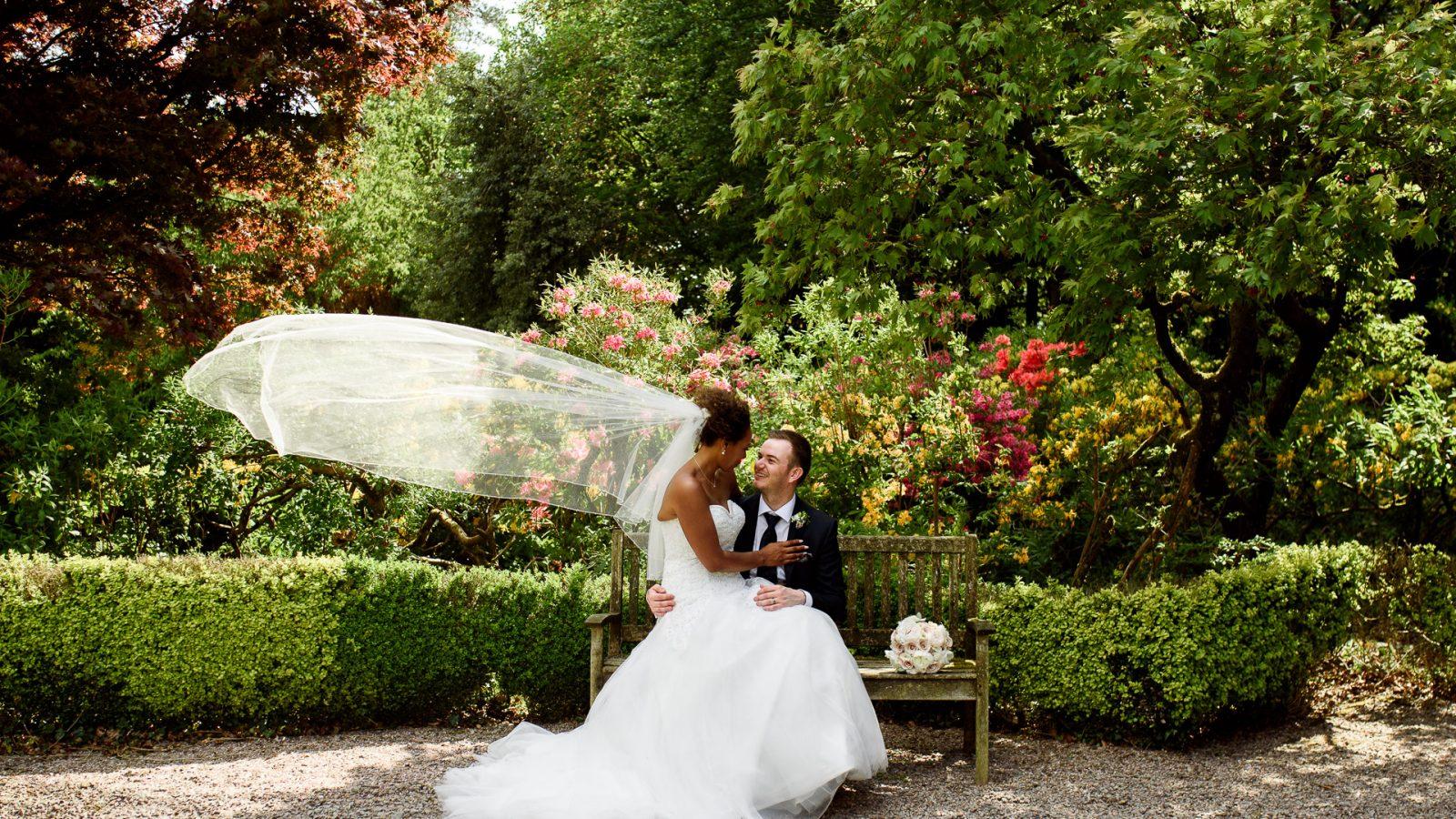 best-wedding-photos-2017-kimberley-and-joseph-bride-on-grooms-knee-veil