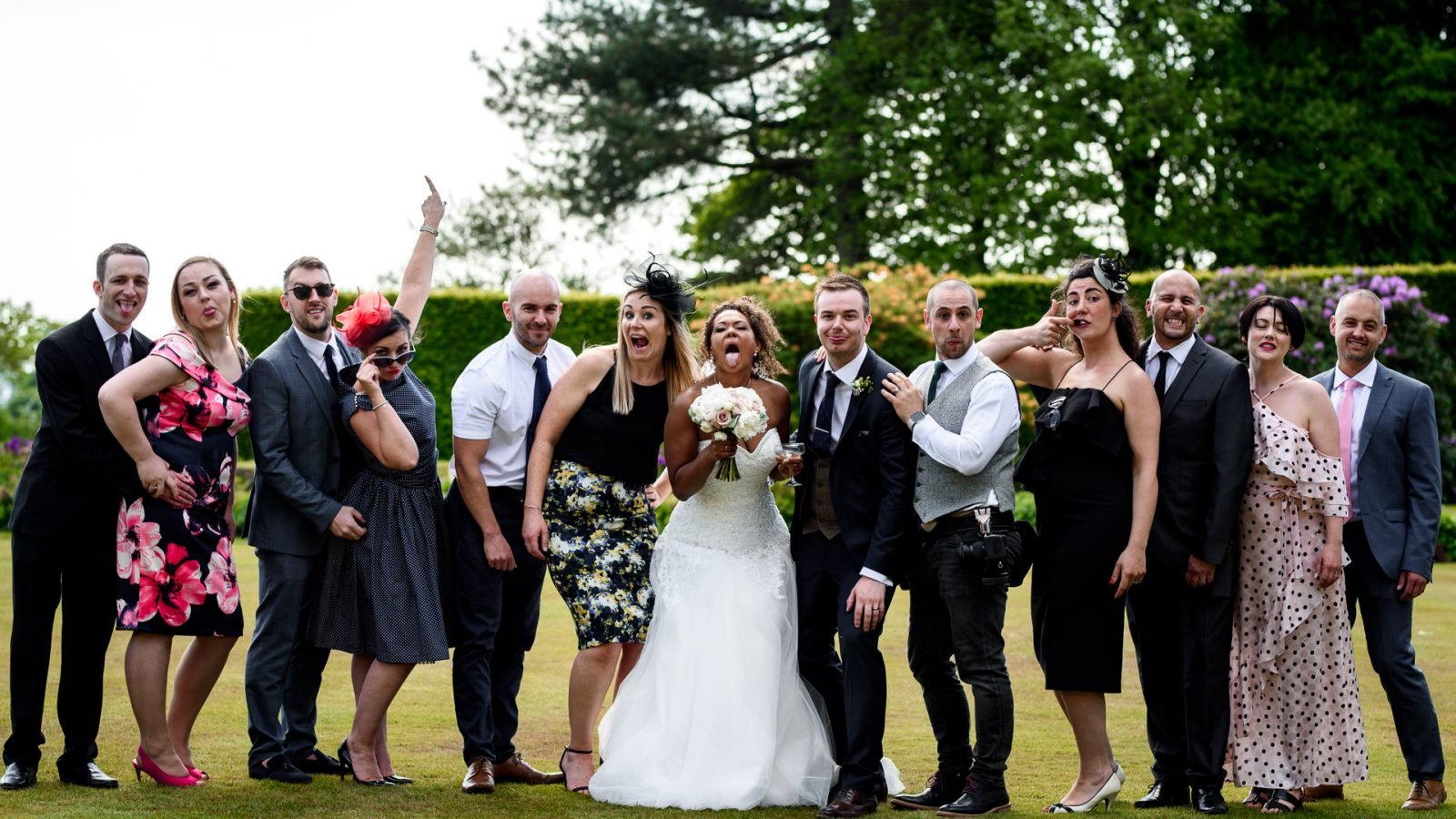 best-wedding-photos-2017-kimberley-and-joseph-posing-with-wedding-guests